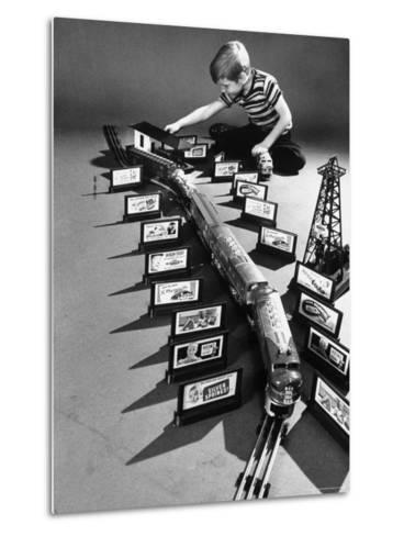 Little Boy Playing with a Toy Train and Billboard Set-Walter Sanders-Metal Print