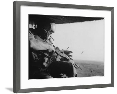 US Military Personnel Firing from Helicopters Onto Viet Cong Targets-Larry Burrows-Framed Art Print