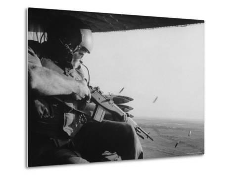 US Military Personnel Firing from Helicopters Onto Viet Cong Targets-Larry Burrows-Metal Print