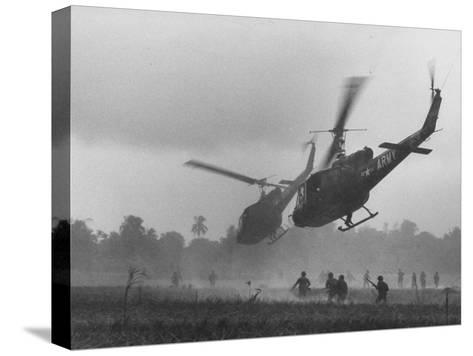 US Helicopters Carrying South Vietnamese Troops in Raid on Viet Cong Positions-Larry Burrows-Stretched Canvas Print