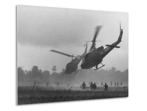 US Helicopters Carrying South Vietnamese Troops in Raid on Viet Cong Positions-Larry Burrows-Metal Print