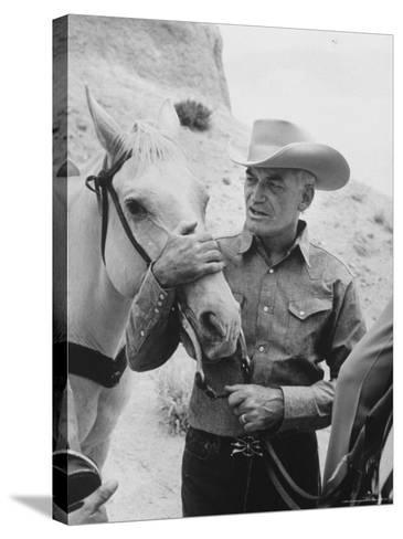 Senator Barry M. Goldwater, Riding His Horse is One of His Hobbies-Leonard Mccombe-Stretched Canvas Print