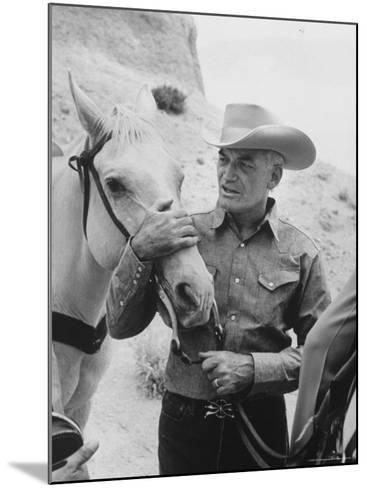 Senator Barry M. Goldwater, Riding His Horse is One of His Hobbies-Leonard Mccombe-Mounted Photographic Print