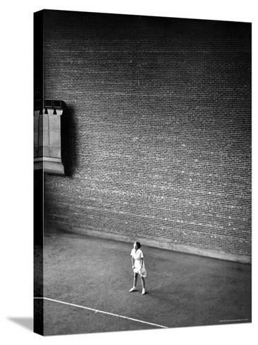 Vassar Student Waiting to Receive a Serve While Playing Indoor Tennis on Campus at Vassar College-Alfred Eisenstaedt-Stretched Canvas Print