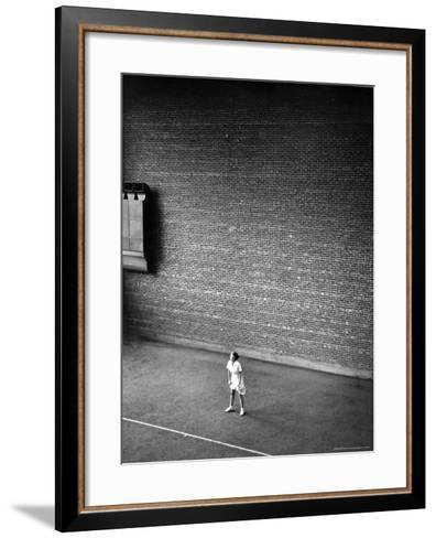Vassar Student Waiting to Receive a Serve While Playing Indoor Tennis on Campus at Vassar College-Alfred Eisenstaedt-Framed Art Print