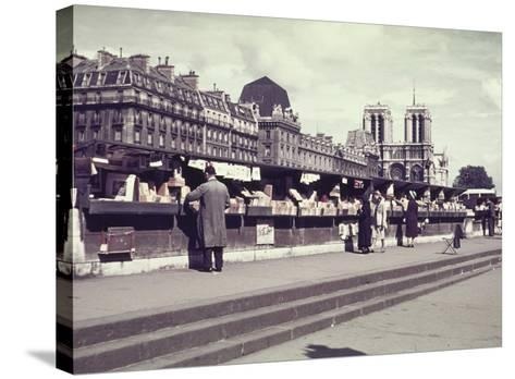 People Shopping at Book and Print Stalls Along the Seine River-William Vandivert-Stretched Canvas Print
