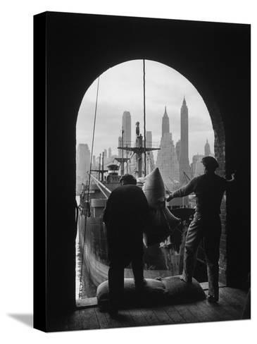 Men Unloading Coffee at Brooklyn Dock. View of Downtown Manhattan in Background-Andreas Feininger-Stretched Canvas Print