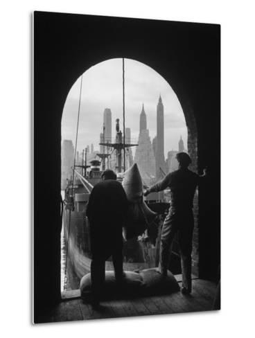 Men Unloading Coffee at Brooklyn Dock. View of Downtown Manhattan in Background-Andreas Feininger-Metal Print