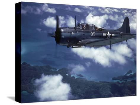 US Navy SBD Dauntless in Flight During Palau Islands Air Raid Attack-J^ R^ Eyerman-Stretched Canvas Print