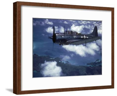 US Navy SBD Dauntless in Flight During Palau Islands Air Raid Attack-J^ R^ Eyerman-Framed Art Print