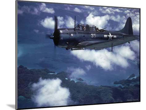 US Navy SBD Dauntless in Flight During Palau Islands Air Raid Attack-J^ R^ Eyerman-Mounted Photographic Print
