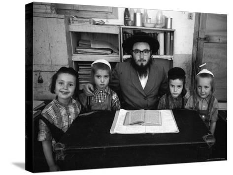 Rabbi Posing with His Young Students Who Are Learning to Read Hebrew at This Orthodox School-Paul Schutzer-Stretched Canvas Print
