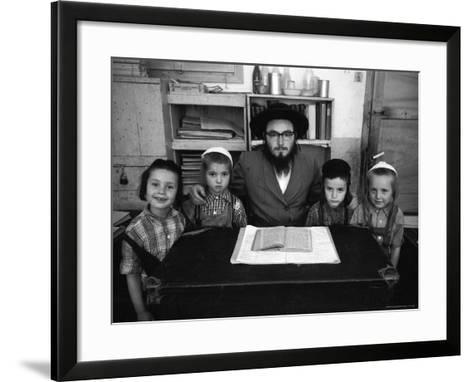 Rabbi Posing with His Young Students Who Are Learning to Read Hebrew at This Orthodox School-Paul Schutzer-Framed Art Print