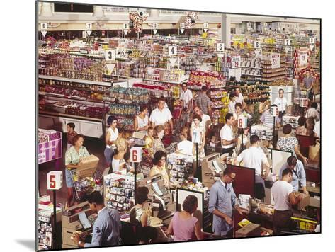 Overhead of Stacked Shelves of Food at Super Giant Supermarket with Shoppers Lined Up at Check Outs-John Dominis-Mounted Photographic Print