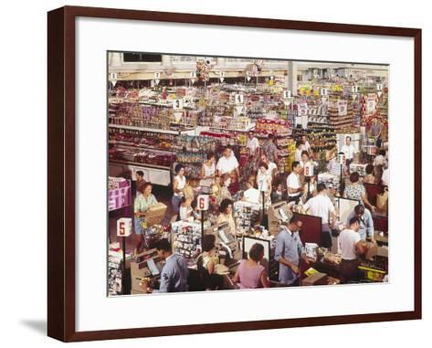 Overhead of Stacked Shelves of Food at Super Giant Supermarket with Shoppers Lined Up at Check Outs-John Dominis-Framed Art Print