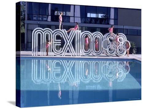 """School Children Playing on Olympic Logo """"Mexico 68"""" Beside Pool-John Dominis-Stretched Canvas Print"""