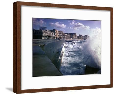 Wave Crashing Against a Breakwater Along the Malecon, a Waterfront Boulevard-Eliot Elisofon-Framed Art Print