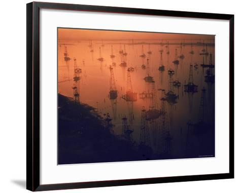 Oil Rigs Dating from the 1920's Dot the Shallows of Galveston Bay-Ralph Crane-Framed Art Print