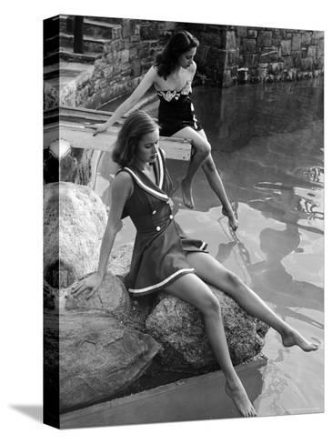 Pair of Models Showing Off New Bathing Suits on the Banks of the River-Nina Leen-Stretched Canvas Print