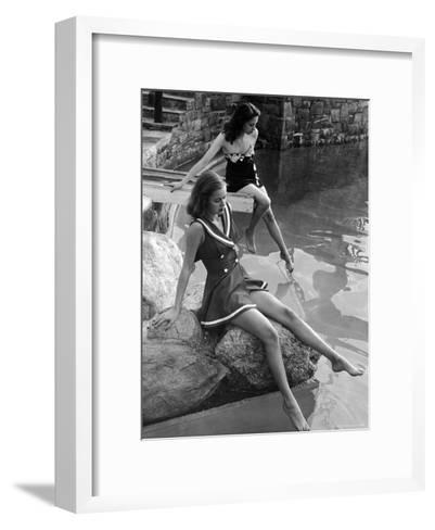 Pair of Models Showing Off New Bathing Suits on the Banks of the River-Nina Leen-Framed Art Print
