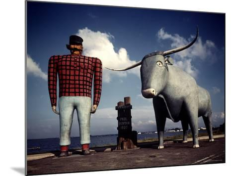 Painted Concrete Sculpture of Paul Bunyon and His Blue Ox, Babe Standing on Shores of Lake Bemidji-Andreas Feininger-Mounted Photographic Print