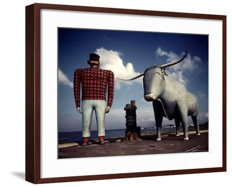 Painted Concrete Sculpture of Paul Bunyon and His Blue Ox, Babe Standing on Shores of Lake Bemidji-Andreas Feininger-Framed Art Print