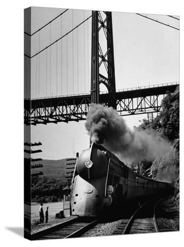 The New York Central Steamliner Releasing Steam as It Comes to a Stop-Peter Stackpole-Stretched Canvas Print
