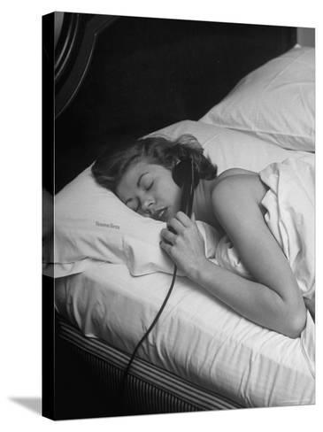 Model Gaby Bouche Talking on the Phone from Her Hotel Room-Nina Leen-Stretched Canvas Print