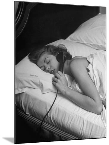 Model Gaby Bouche Talking on the Phone from Her Hotel Room-Nina Leen-Mounted Photographic Print