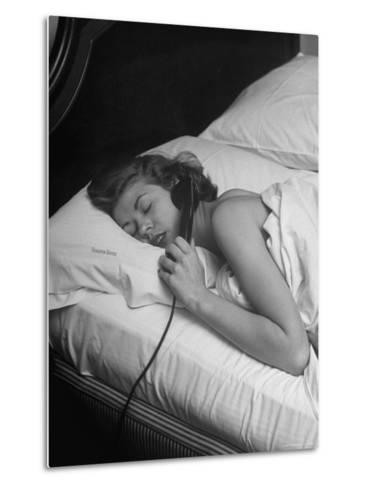 Model Gaby Bouche Talking on the Phone from Her Hotel Room-Nina Leen-Metal Print