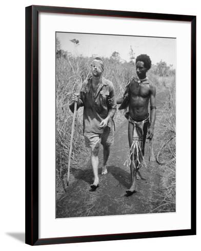 Papuan Native Helping a Wounded Australian Infantryman Along Road Away from the Buna Battlefront-George Silk-Framed Art Print