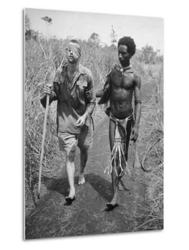 Papuan Native Helping a Wounded Australian Infantryman Along Road Away from the Buna Battlefront-George Silk-Metal Print