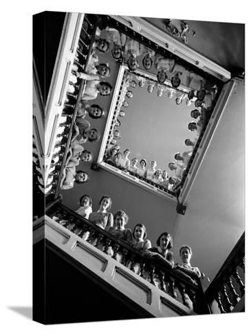 Student Nurses Lining the Railings of Stairwell at Roosevelt Hospital-Alfred Eisenstaedt-Stretched Canvas Print