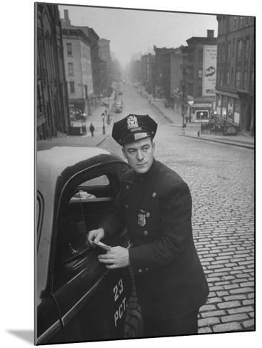 Ny Patrolman James Murphy Standing by His 23 Precinct Squad Car on Street of His East Harlem Beat-Tony Linck-Mounted Photographic Print
