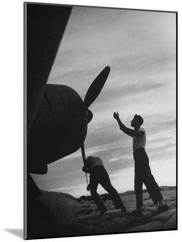 US Marines Pushing Through the Props of Bomber at US Naval Base on Midway Island-Frank Scherschel-Mounted Photographic Print