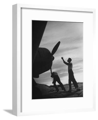 US Marines Pushing Through the Props of Bomber at US Naval Base on Midway Island-Frank Scherschel-Framed Art Print