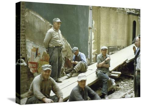 """Men from Demolition Crew on Their Break in Story """"The Wreckers""""-Walker Evans-Stretched Canvas Print"""