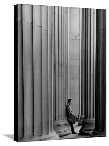Student Leaning Against Ionic Columns at Entrance of Main Building at MIT-Gjon Mili-Stretched Canvas Print
