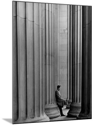 Student Leaning Against Ionic Columns at Entrance of Main Building at MIT-Gjon Mili-Mounted Photographic Print