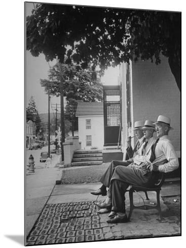 The Bench in Front of the Pawling National Bank is a Gathering Place For Men of the Town-Nina Leen-Mounted Photographic Print