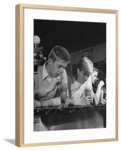 Teen Age Boys and Girls Drinking Milkshakes in Drug Store-Nina Leen-Framed Art Print
