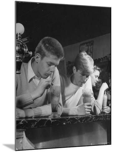 Teen Age Boys and Girls Drinking Milkshakes in Drug Store-Nina Leen-Mounted Photographic Print
