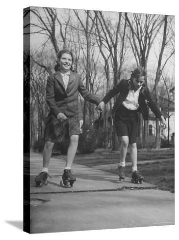 """Typical 10 Year Old Girls Known as """"Pigtailers"""" Roller Skating-Frank Scherschel-Stretched Canvas Print"""
