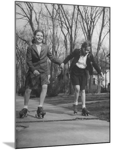 """Typical 10 Year Old Girls Known as """"Pigtailers"""" Roller Skating-Frank Scherschel-Mounted Photographic Print"""