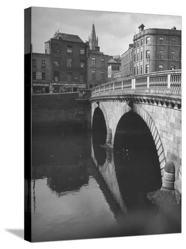 View of the Liffey River and the Metal Bridge in Dublin-Hans Wild-Stretched Canvas Print
