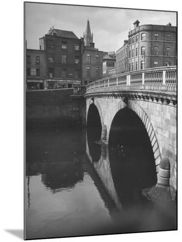 View of the Liffey River and the Metal Bridge in Dublin-Hans Wild-Mounted Photographic Print