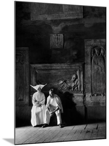 Two People Sitting in Hospital Where St. Catherine Nursed People with the Plague-Walter Sanders-Mounted Photographic Print