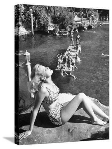 Young Girl Sunbathing at the Venetian Pool-Allan Grant-Stretched Canvas Print