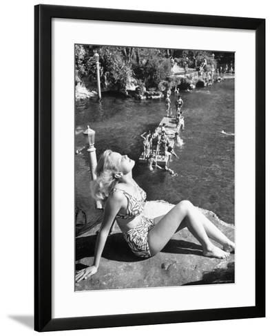 Young Girl Sunbathing at the Venetian Pool-Allan Grant-Framed Art Print