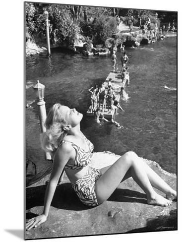 Young Girl Sunbathing at the Venetian Pool-Allan Grant-Mounted Photographic Print